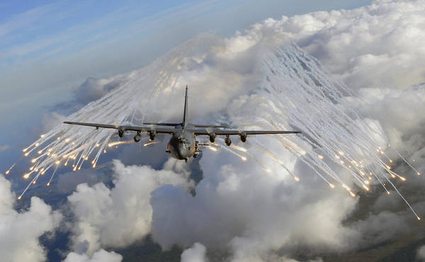 Armament Photograph - An Ac-130u Gunship Jettisons Flares by Stocktrek Images