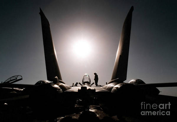 Uss George Washington Wall Art - Photograph - An Aircraft Mechanic Works On An F-14b by Stocktrek Images