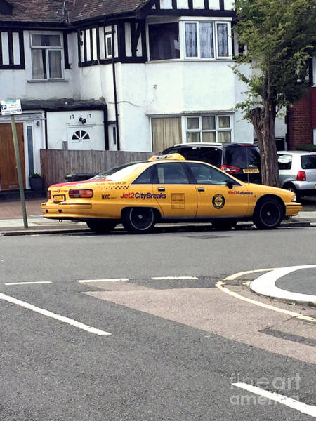 Photograph - An American Taxi In London by Doc Braham