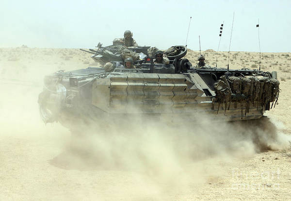 Photograph - An Amphibious Assault Vehicle Kicks by Stocktrek Images