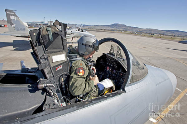 Airbase Photograph - An F-15 Pilot Performs Preflight Checks by HIGH-G Productions