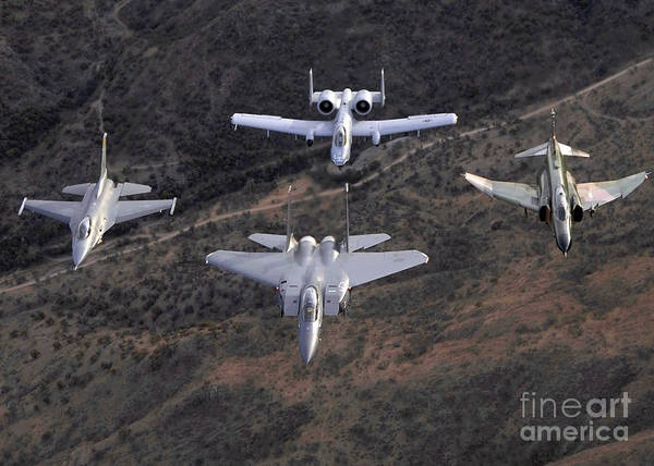 F-16 Photograph - An F-16 Fighting Falcon, F-15 Eagle by Stocktrek Images