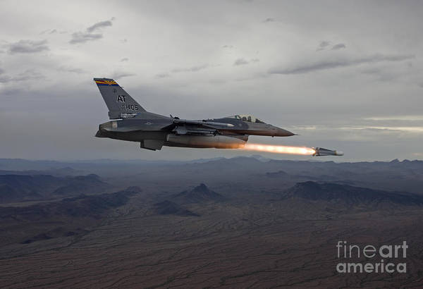 Aerial Combat Photograph - An F-16 Fighting Falcon Fires An Agm-65 by HIGH-G Productions