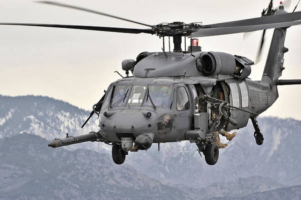 Armament Photograph - An Hh-60 Pave Hawk Helicopter In Flight by Stocktrek Images