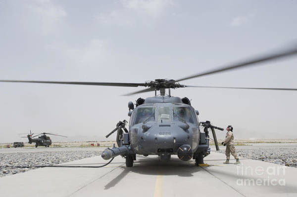 Utility Helicopter Photograph - An Hh-60 Pave Hawk Lands After A Flight by Stocktrek Images