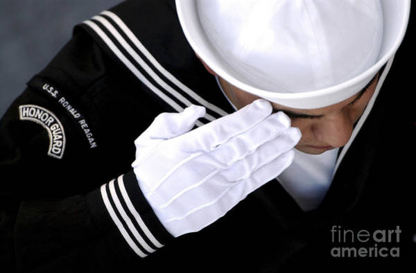 Honor Guard Photograph - An Honor Guard Member Renders A Salute by Stocktrek Images