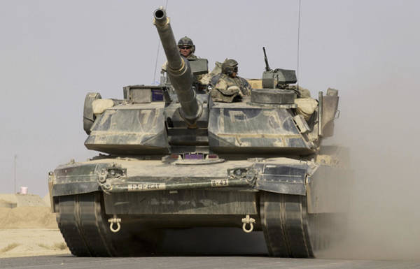 Iraqi Photograph - An M1a1 Abrams Tank Heading by Stocktrek Images