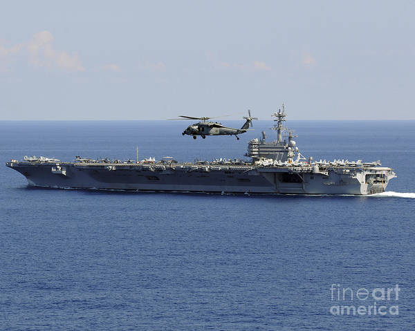 Uss George H W Bush Wall Art - Photograph - An Mh-60s Seahawk Helicopter Flies by Stocktrek Images