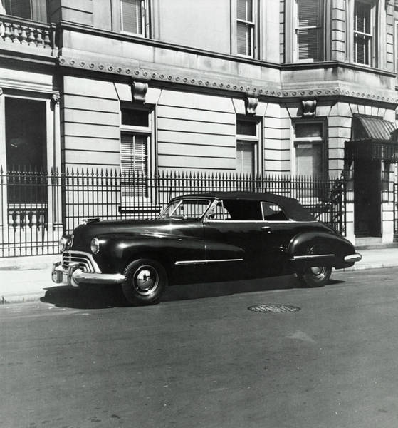 Transportation Photograph - An Oldsmobile Car by Constantin Joffe