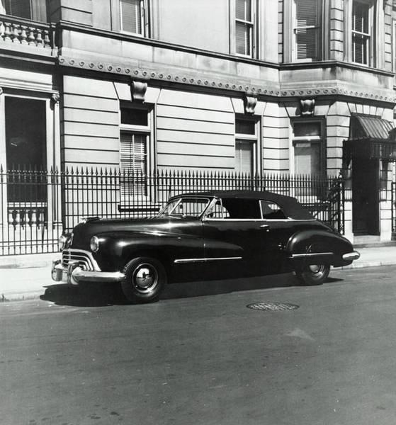 Vintage Car Photograph - An Oldsmobile Car by Constantin Joffe