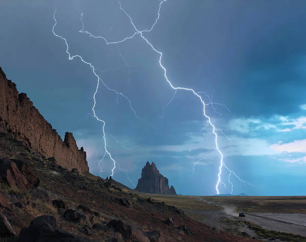 Electric Peak Wall Art - Photograph - An Suv Races Away From A Thunderstorm At Shiprock, New Mexico by Derrick Neill