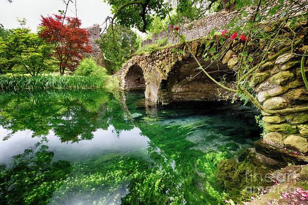 Wall Art - Photograph - Ancient Bridge Over The Ninfa Creek by George Oze
