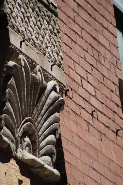 Photograph - Angled View Or Decorative Molding On Brick Building by Colleen Cornelius