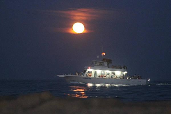 Photograph - Angler Cruises Under Full Moon by Robert Banach