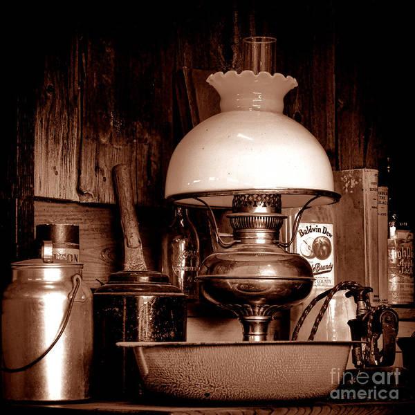 Photograph - Antique Kerosene Lamp In A Kitchen by Olivier Le Queinec