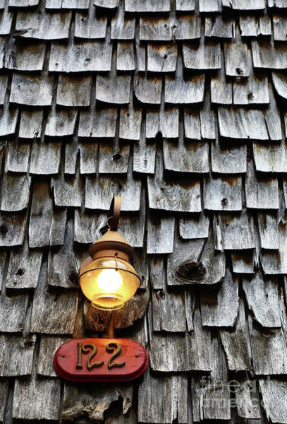 Photograph - Antique Lamp And Wooden Tiles Frederick Maryland by James Brunker