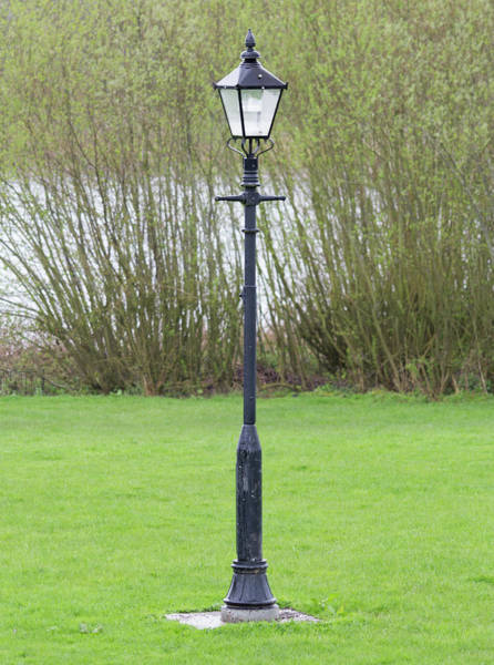Photograph - Antique Lamp Post Near Water by Scott Lyons