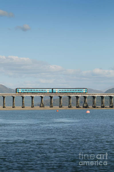 Photograph - Arriva Train Crossing The Barmouth Bridge, Wales Uk by Keith Morris