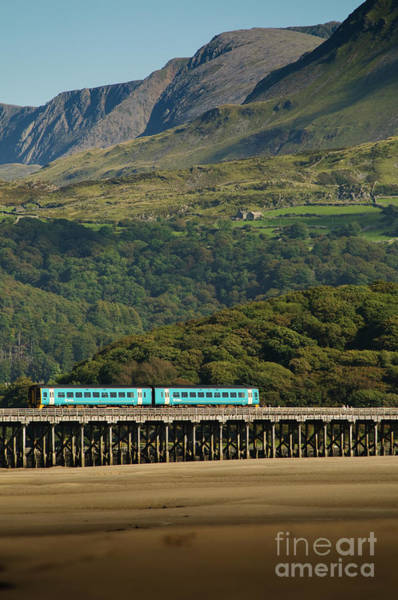 Photograph - Arrive Train Crossing The Barmouth Bridge, Wales Uk by Keith Morris