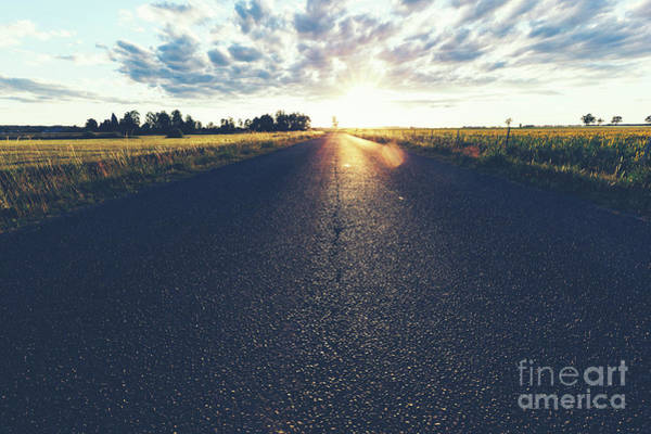 Straight Ahead Wall Art - Photograph - Asphalt Country Road, A Grass Field And Sunset. by Michal Bednarek