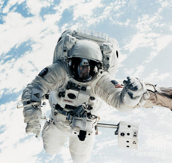 Astronomy Photograph - Astronaut by Nasa