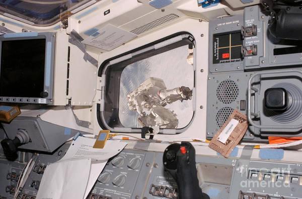 Photograph - Astronaut Taking Spacewalk by Nasa