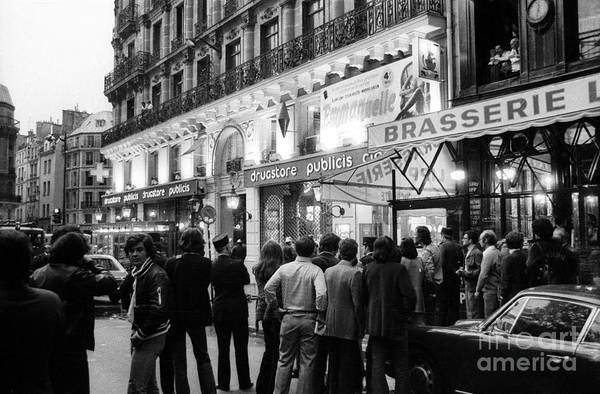 Wall Art - Photograph - Attack At The Drugstore Saint Germain In Paris On September 15, 1974 by French School