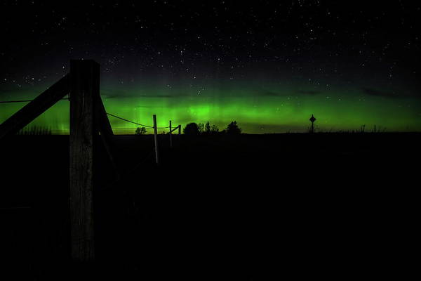 Photograph - Aurora At The Corner Post by Dale Kauzlaric