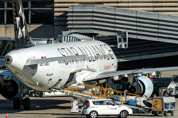 Hs Photograph - Austrian Star Alliance At Preparation Aircraft Befthe Gate Of Zurich by Roberto Chiartano