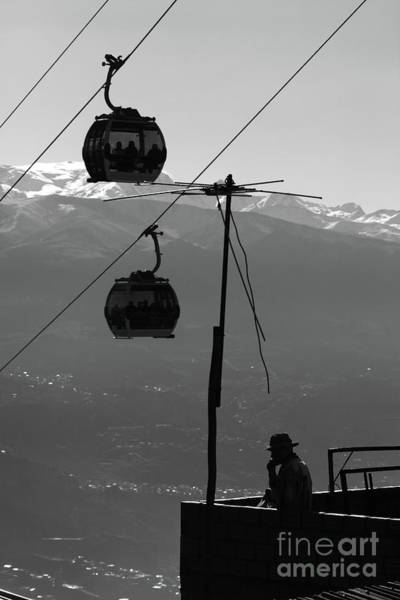 Photograph - Aymara Man Chewing Coca Leaves Under Cable Cars La Paz Bolivia by James Brunker