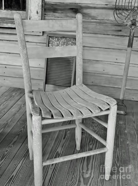 Photograph - B W Lone Red Chair by D Hackett