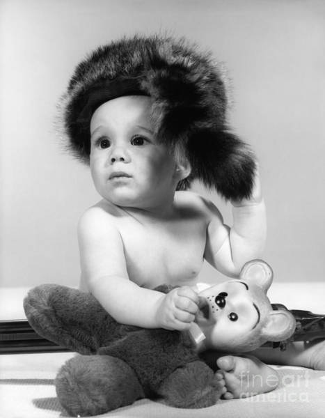 Wall Art - Photograph - Baby In Coonskin Hat, C.1960s by H. Armstrong Roberts/ClassicStock
