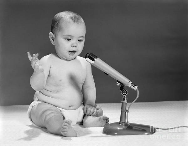 Broadcaster Wall Art - Photograph - Baby Speaking Into Microphone, C.1960s by H. Armstrong Roberts/ClassicStock