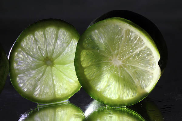 Photograph - Backlit Limes by Angela Murdock