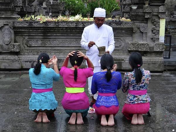 Photograph - Bali Temple Women Blessing by Exploramum Exploramum