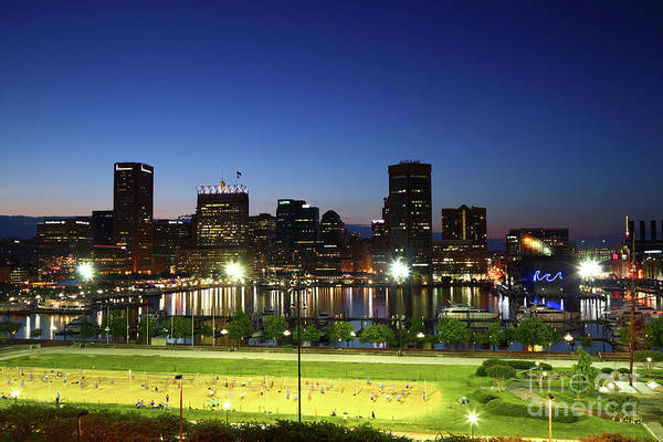 Photograph - Baltimore Beach And Inner Harbor At Twilight by James Brunker