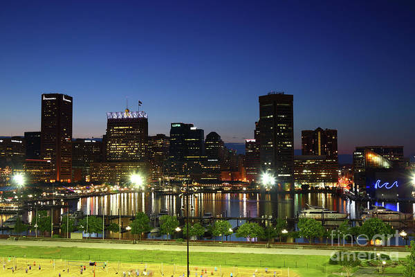 Photograph - Baltimore Inner Harbor Skyline At Twilight by James Brunker