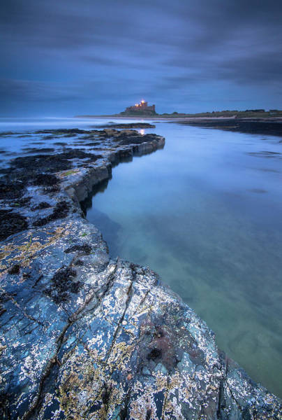 Wall Art - Photograph - Bamburgh Castle Blue Hour From The Rocks After Dark by Anita Nicholson