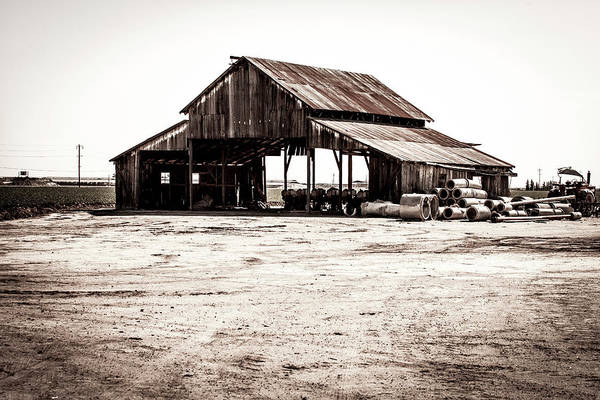 Photograph - Barn And Irrigation Pipes by Gene Parks