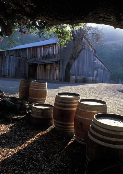 Wine Barrels Photograph - Barn And Wine Barrels by Kathy Yates