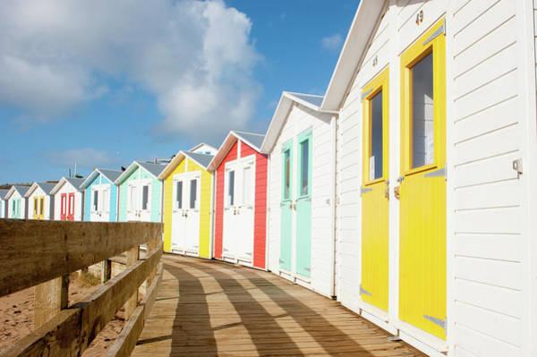 Photograph - Beach Huts And Boardwalk by Helen Northcott