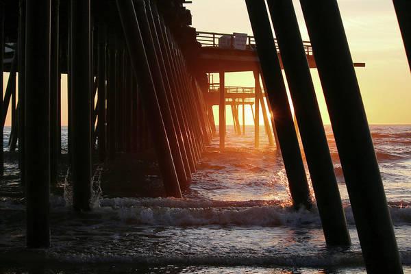 Under The Pier Photograph - Beach Light by Art Block Collections