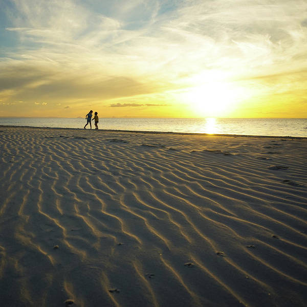 Photograph - Beach Silhouettes And Sand Ripples At Sunset by Keiran Lusk