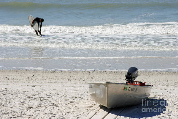 Photograph - Beached Boat And Bodyboarder In Naples Florida by William Kuta