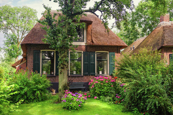 Wall Art - Photograph - Beautiful Cottage With Green Garden In Giethoorn. The Netherlands by Jenny Rainbow