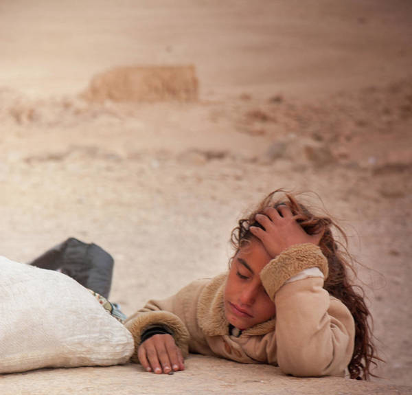 Stone Wall Art - Photograph - Bedouin Girl At The Ruins Of The  Ancient City Of Palmyra, Syria by Iordanis Pallikaras