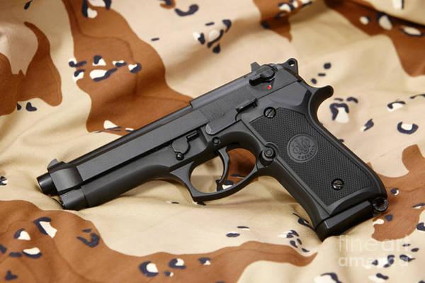 Beretta Photograph - Beretta 92fs Handgun On Old Persian Gulf War Desert Battle Dress Uniform by Joe Fox