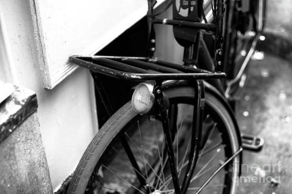 Photograph - Bicycle Light In Amsterdam Mono by John Rizzuto