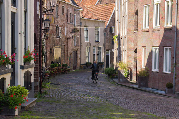 Bernadette Photograph - Bicyclist In Deventer by Bernadette Van der Vliet