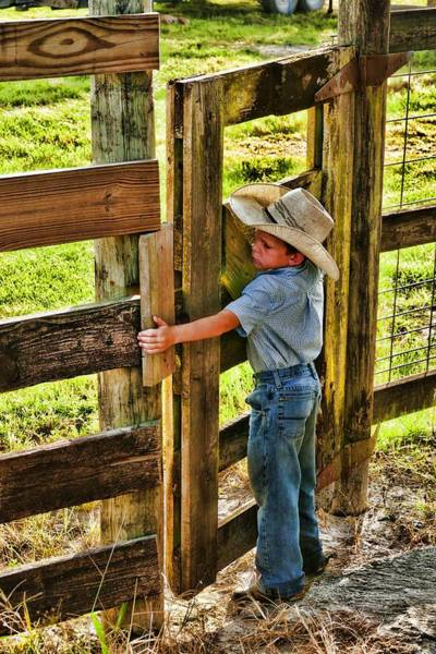 Wall Art - Photograph - Big Gate Little Cowboy by Don Columbus